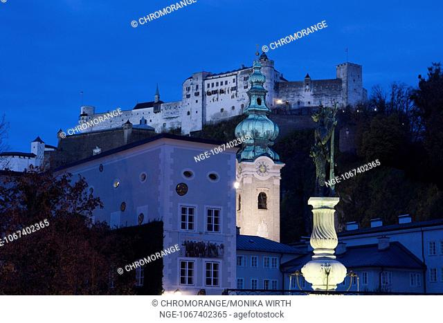Fortress Hohensalzburg at night, in the front Wilder-Mann-Brunnen fountain, Salzburg, UNESCO World Heritage Site, Salzburger Land, Austria, Europe