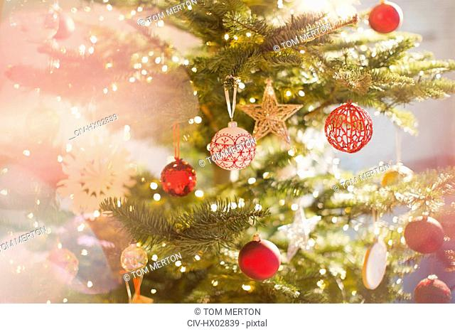 Red, white and gold ornaments and star on Christmas tree