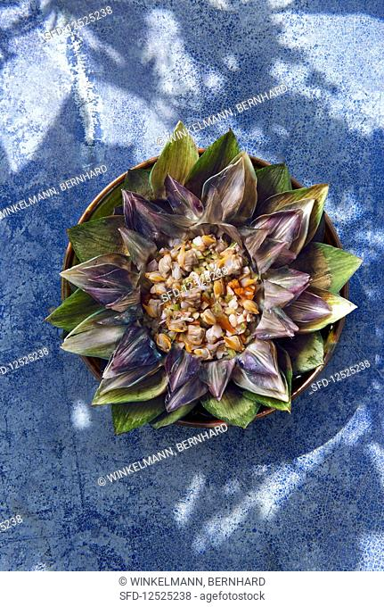 Mussel and shrimp salad with carrots in an artichoke