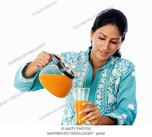 Woman pouring juice in a glass