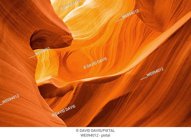 Lower Antelope Canyon located near Page Arizona on the Navajo reservation  A slot canyon is a narrow canyon, formed by the wear of water rushing through rock