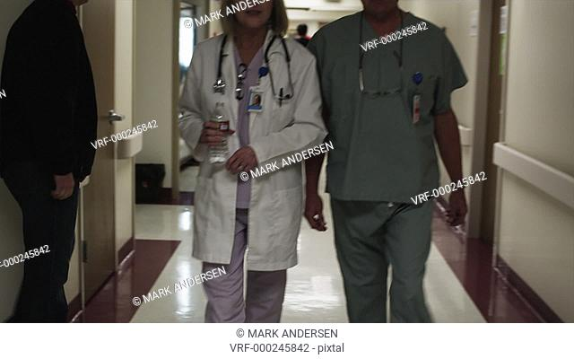 MS DS Female and male doctor walking through hospital corridor / Payson, Utah, USA