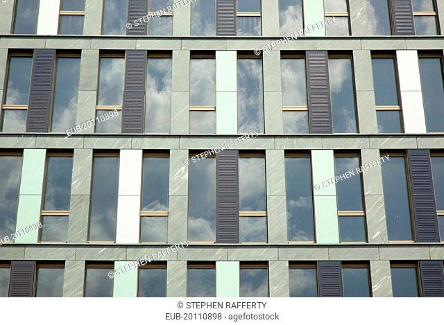 Mitte Exterior of office building clad with colourful panels including Solar