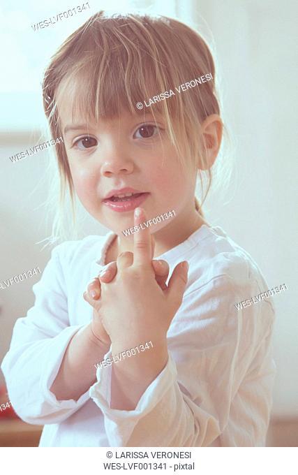 Portrait of little girl showing forefinger