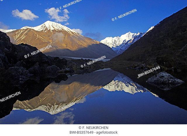 Tsergo Ri and Gangchempo mirrored in a lake near Kyanche Gompa, Nepal, Langtang Himal