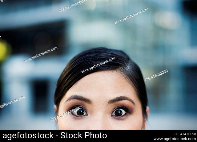 Close up of wide-eyed woman