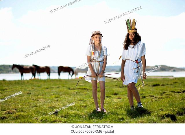 Girls wearing Native American costumes
