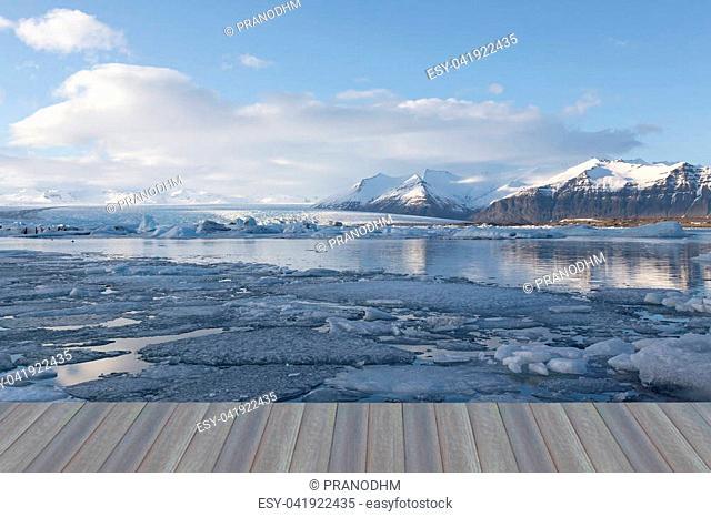 Opening wooden floor, Iceland Jakulsalon lagoon glacier with blue skyline background, natural winter season landscape