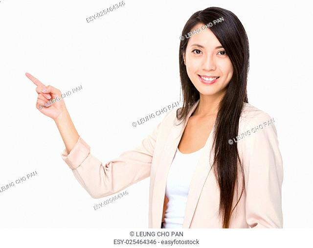 Asian businesswoman with finger point up to promote something