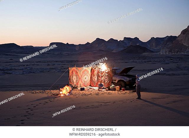 Tourists overnight with Jeep in White Desert National Park, Libyan Desert, Egypt