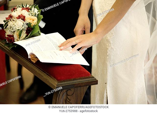 Hands of the bride, in church