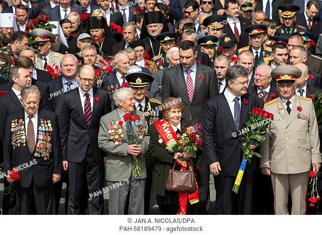 Ukrainian President Petro Poroshenko (2nd R), Kiev Mayor Vitali Klitschko (--rear) with WWII veterans and Ukrainian officials attend Victory Day celebrating in...