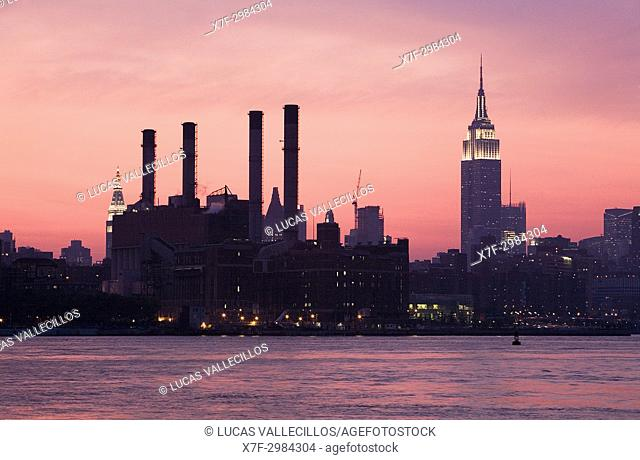 Skyline of Manhattan with Empire state building, from East River,New York City, USA