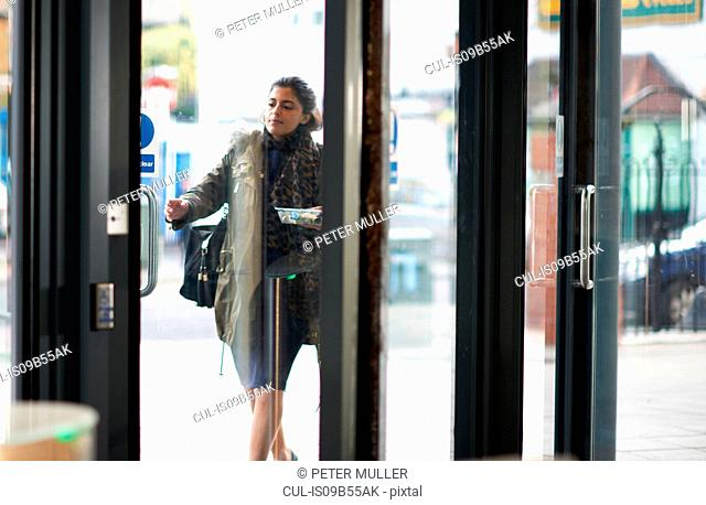 Woman arriving at entrance to work