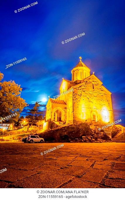Illuminated Metekhi st Virgin Church, Tbilisi old town, Georgia