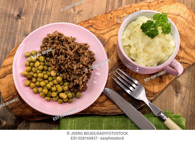 traditional scottish dish, mince and tatties with parsley in a cup with pea