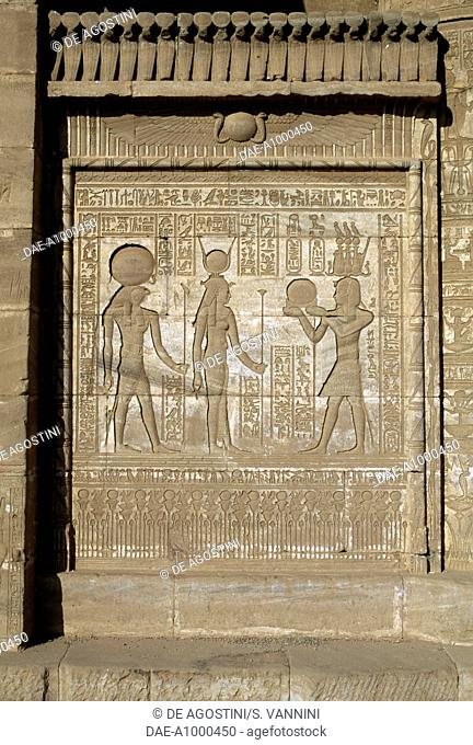 The Roman emperor Trajan depicted as pharaoh offering the solar disc to the goddess Hathor and Horus, relief of the Mammisi (birth temple), Temple of Hathor