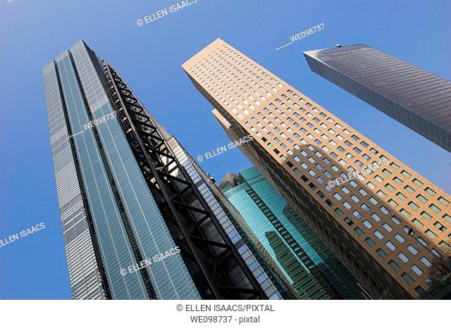 Tall modern office buildings towering into the sky in the Shiodome district of Tokyo, Japan