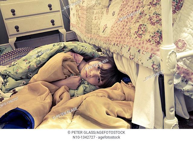 Preteen girl lying between her two beds