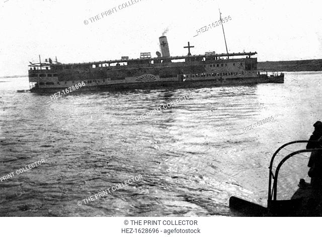 Red Cross river boat going up the Tigris River, Mesopotamia, WWI, 1918. Mesopotamia, formerly part of the Turkish Ottoman empire