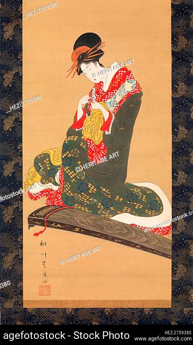 Woman Putting on Finger Plectrums to Play the Koto, early 19th century. Creator: Utagawa Toyohiro