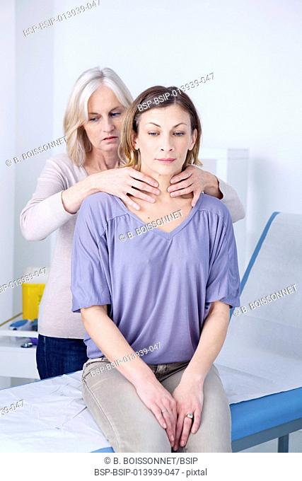 Doctor examining the thyroid of a patient