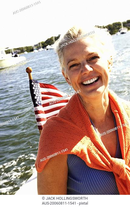 Portrait of a mature woman smiling in a boat