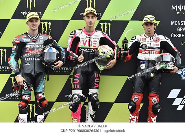 Road racers L-R John McPhee (Britain), Tony Arbolino (Italy) and Niccolo Antonelli (Italy) are seen on the podium after Moto3 category qualifying for the Czech...
