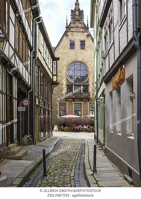 View through the narrow lane of Stieg Alley to the Eastern gable of the old medieval town hall of Quedlinburg, Saxony-Anhalt, Germany