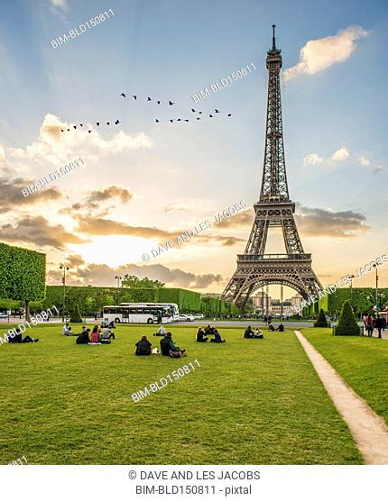 Tourists relaxing in park near Eiffel Tower, Paris, France