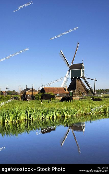 Windmill the Wingerdse Molen close to the Dutch village Bleskensgraaf seen on a clear and crisp day in spring