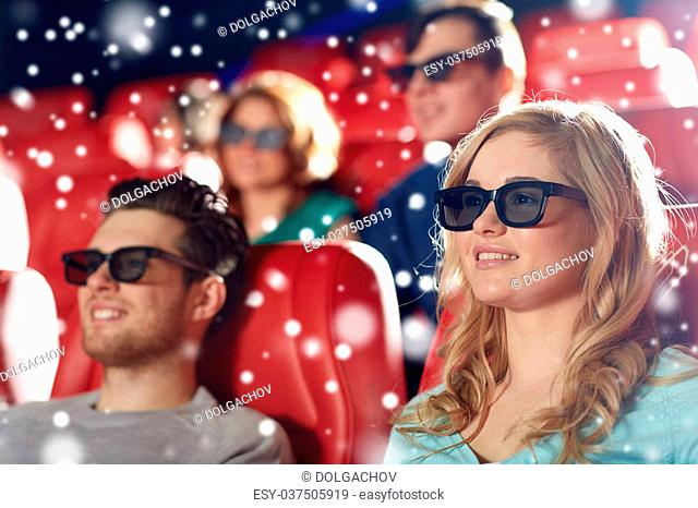 cinema, entertainment and people concept - happy friends with 3d glasses watching movie in theater over snowflakes