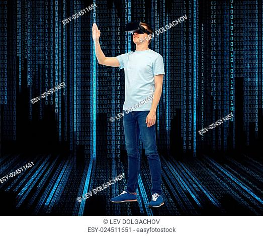 3d technology, virtual reality, entertainment, cyberspace and people concept - man with virtual reality headset or 3d glasses playing game and touching...