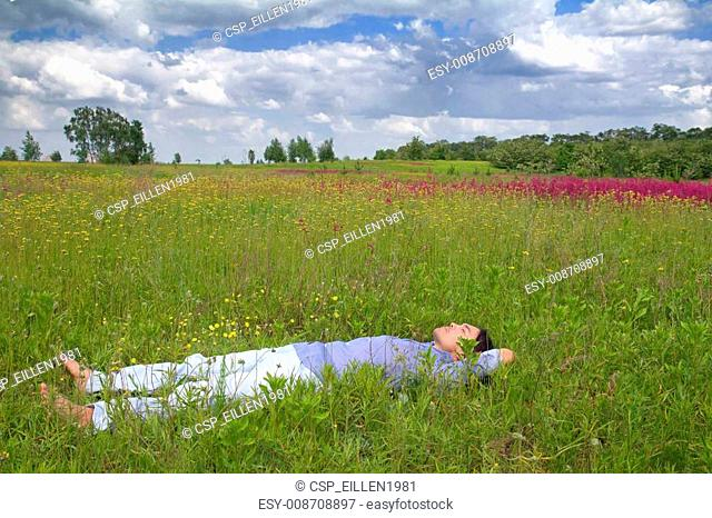 Man lying on a spring meadow
