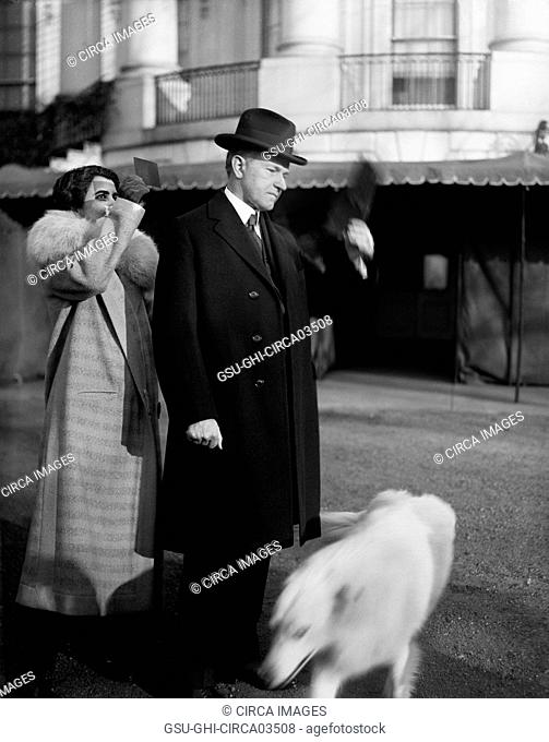 U.S. President Calvin Coolidge and First Lady Grace Coolidge viewing Solar Eclipse from White House Lawn, Washington DC, USA, Harris & Ewing, January 24, 1925