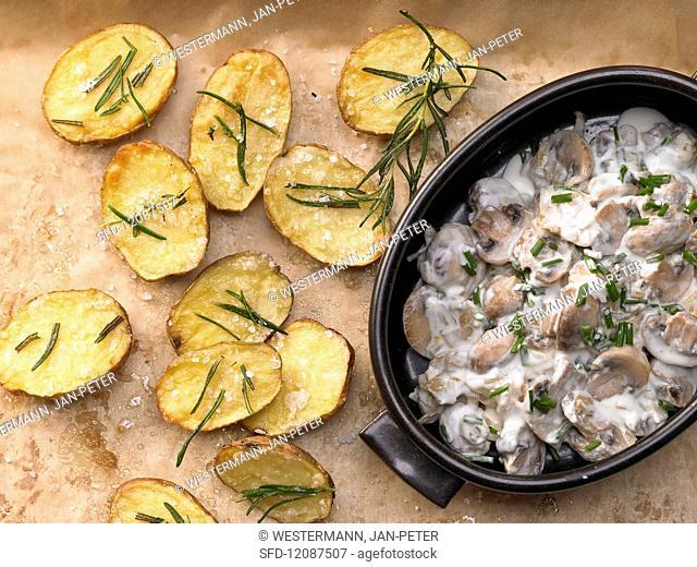 Baked rosemary potatoes with mushrooms