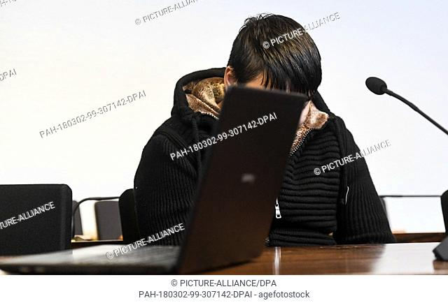 02 March 2018, Germany, Freiburg: The defendant Hussein K. sits behind a laptop in a court room of the district court. The defendant confessed