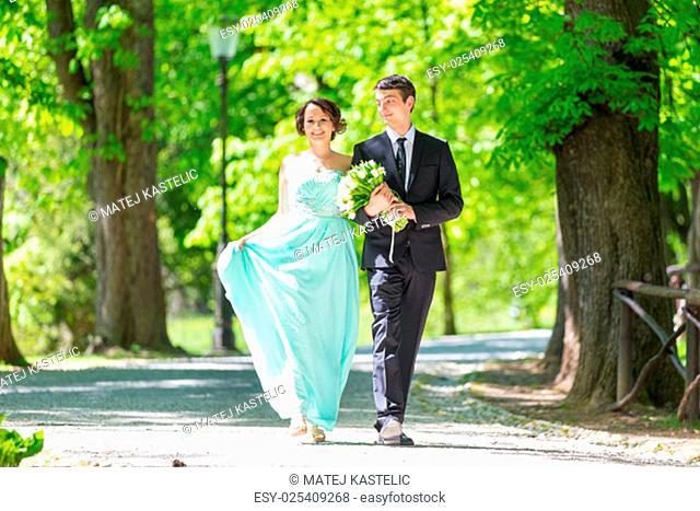 Bride and groom. Portrait of a loving wedding couple strolling in Tivoli park in Ljubljana, Slovenia