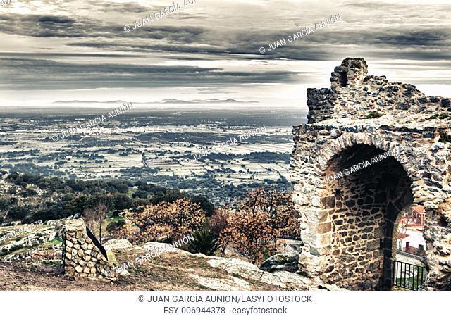 Montanchez town castle remains at sunrise, Caceres, Spain