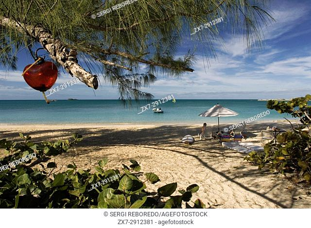 Cat Island, Bahamas. Hotel Fernandez Bay Village resort. Tourists relaxing on the beach. Heart hanging from a tree