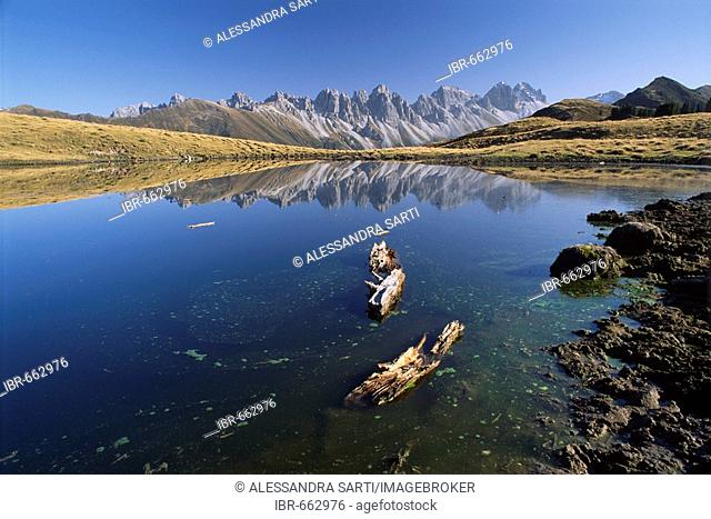 Kalkoegel Mountains reflected in the surface of an alpine lake in autumn, North Tirol, Austria, Europe