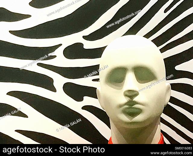 Mannequin's head against abstract background