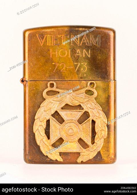 Very old lighter from the Vietnam war on a white background