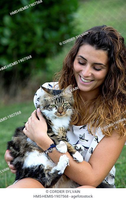 France, Bas Rhin, Bischoffsheim, one person with a cat