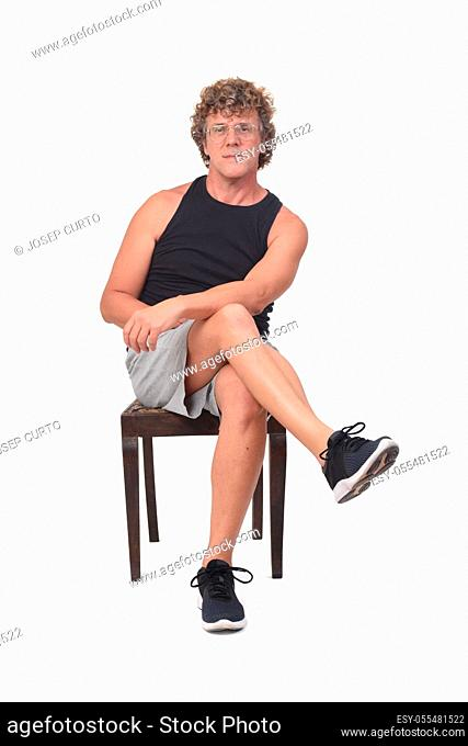 front view of a man sitting on white background,