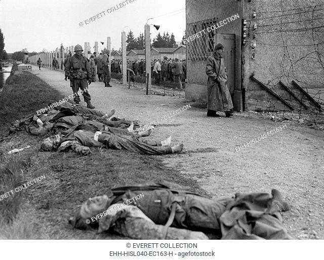 Bodies of former SS guards lie on the bank of a moat surrounding the Dachau Concentration Camp. Liberated prisoner's killed the guards by beating them to death