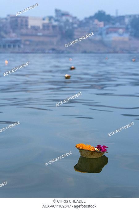 Offerings for puja or worship in the Ganges River, Varanasi, formerly Benares, Uttar Pradesh, IndiaGanges River, Varanasi, formerly Benares, Uttar Pradesh