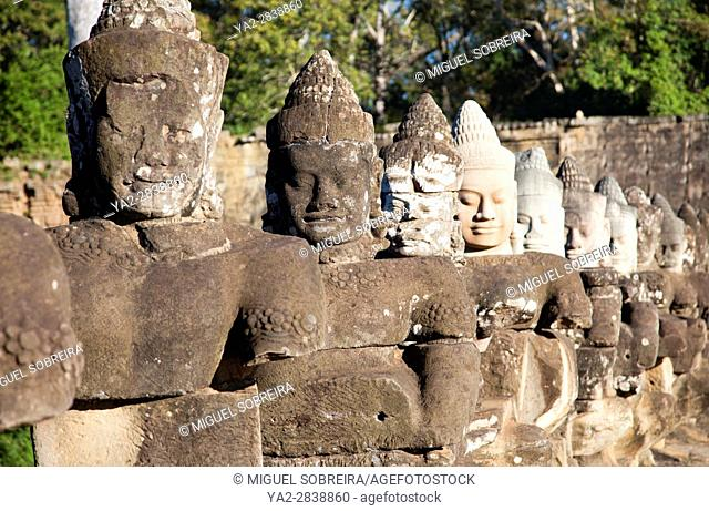 Stone Figures with Large Heads Line the Access Bridge Road to Actual Bayon Temple - Siem Reap - Cambodia