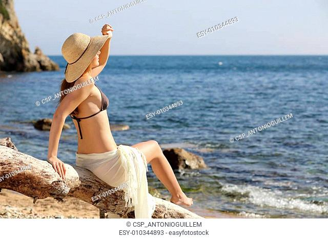 Beauty woman on the beach looking forward on vacations