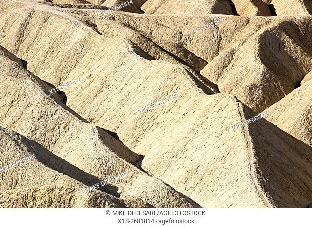 Thin sandtone ridges eroded over the ages take on a serpentine appearance at Zabriskie Point in Death Valley